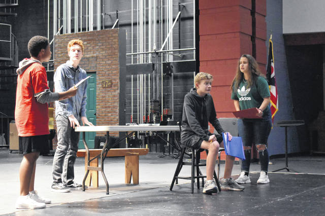 "Part of the cast of ""The Crucible"" rehearse a scene Tuesday afternoon. From left to right are Jackson Collins, Aidan Ferguson, George Callendine and Celeste Hawkins."