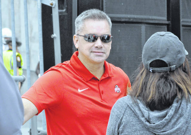 Ohio State head basketball coach Chris Holtmann stands near the south stands during a football game earlier this season in Ohio Stadium.