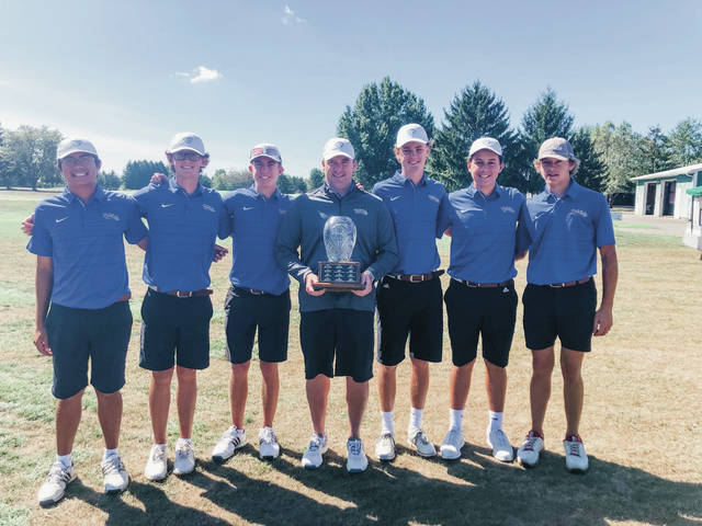 Olentangy Liberty coach Ryan Snivley, middle, is flanked by his team after the Patriots won the First Commonwealth Bank Cup Thursday afternoon at Millcreek.