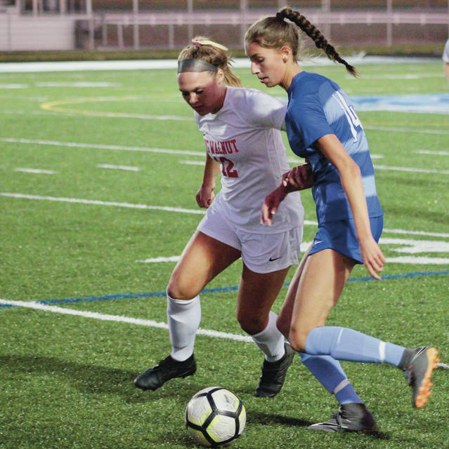 Big Walnut's Avery Schone, left, and Olentangy Berlin's Ashley Kerekes battle for possession during the first half of Thursday's non-league showdown in Delaware.