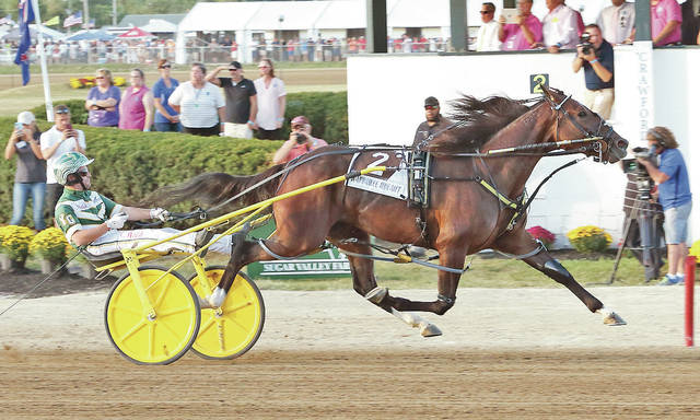 Yannick Gingras and Warrawee Ubeaut close in on the finish line to win the $259,600 Jugette for three-year-old filly pacers Wednesday at the Delaware County Fairgrounds.