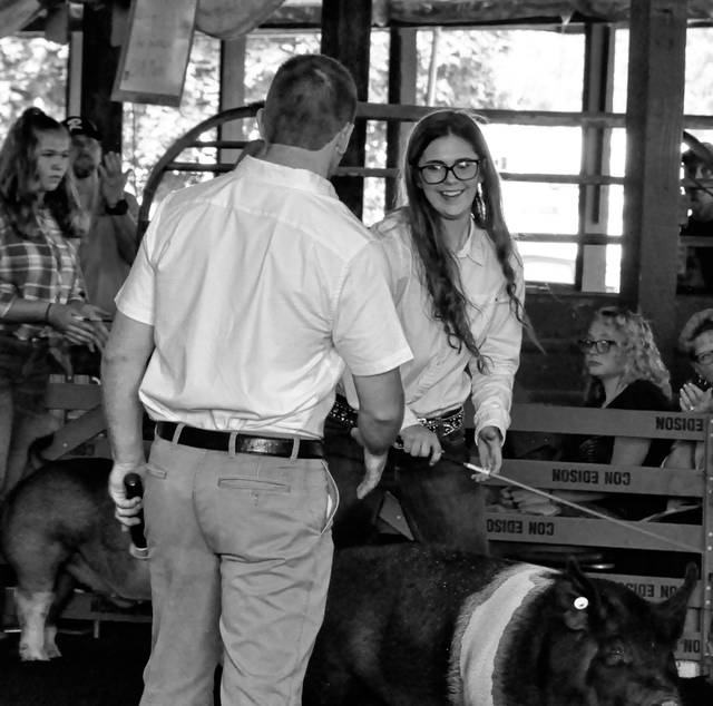 Buckeye Valley student Carlissa Jenkins shows her excitement after the judge announced her hog had been named Grand Champion Market Barrow Monday at the Delaware County Fair.