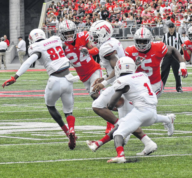 Ohio State defensive back Shaun Wade (24) and linebacker Baron Browning (5) swarm to the football during OSU's Aug. 31 win against Florida Atlantic.