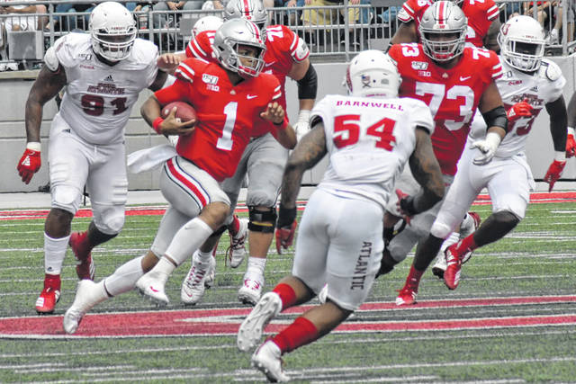 Ohio State QB Justin Fields looks for running room against Florida Atlantic during last week's 45-21 win.
