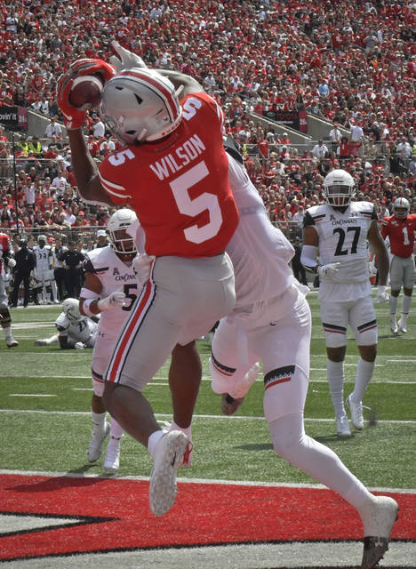True freshman Garrett Wilson hauls in his first career touchdown catch on a 9-yard pass from Justin Fields in the second quarter.