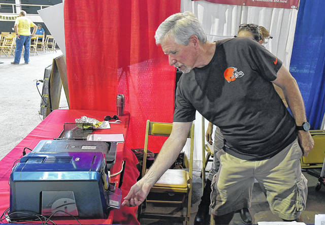Jon Briney filed his DD214 with the Delaware County Recorder's Office years ago. While visiting the fair this week, he stopped by to renew his veteran's ID card. Briney only had to wait a few minutes for the card to pop out of the machine.