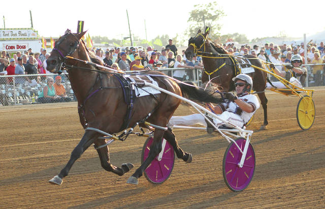 Southwind Ozzi, driven by Brian Sears, cruises to the finish line en route to winning the final heat of the 2019 Little Brown Jug Thursday afternoon at the Delaware County Fairgrounds.