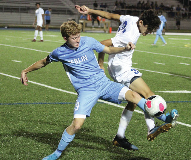 Olentangy Berlin's Will Harrington (9) and Olentangy's Michael Zenios battle for possession during the first half of Tuesday's non-league showdown in Delaware.