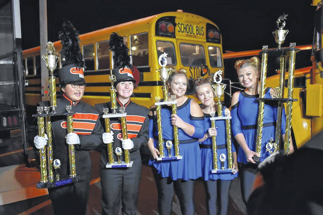 Leaders of the Hayes High School Marching Band and Color Guard accept awards at the Band of Gold Invitational held Saturday. (From left to right: Drum Major Hannah Stoll, Drum Major Lizzy Childers, and Color Guard leaders Hannah Reeves, Lexi Herring, and Alexia Dickie.