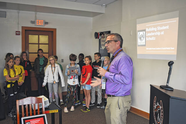 Schultz Elementary School Principal Travis Woodworth, along with the fifth grade house leaders at Schultz and the Schultz social media team, give a presentation to the Delaware City Schools Board of Education Monday.