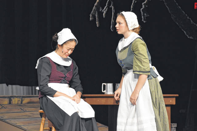 Mary Warren (left, played by Rena Ouyang) breaks down in tears after discussing the ongoing witch trials with Elizabeth Proctor (right, played by Hailey Wright) during a rehearsal in the Hayes auditorium Thursday afternoon.