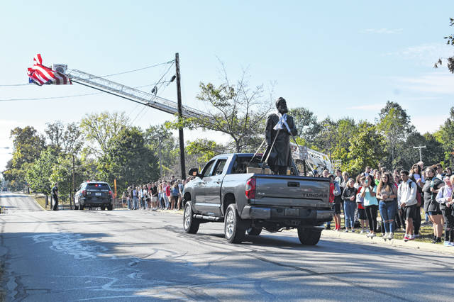 A statue of President Rutherford B. Hayes drives past Rutherford B. Hayes High School Wednesday morning during its brief tour of the city.