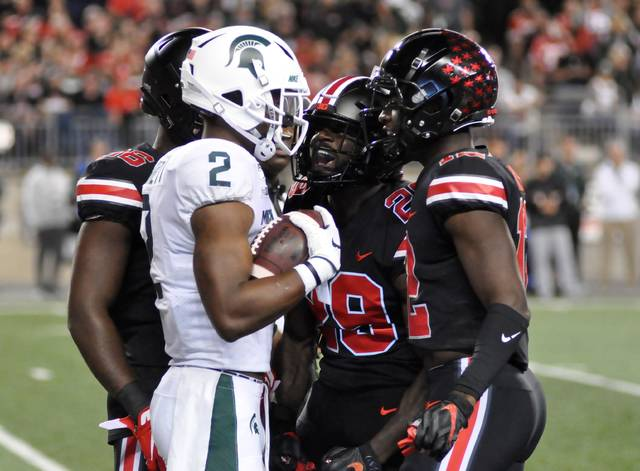 Ohio State's Marcus Hooker (29) exchanges words with Michigan State's Julian Barnett during Saturday's game in Ohio Stadium.