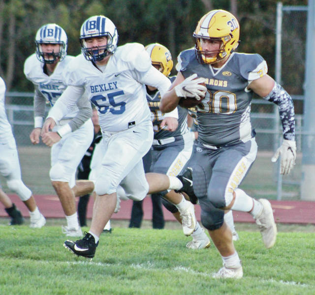 Buckeye Valley's Andre Ash (30) picks up big yardage on the opening kickoff to get his team off to a solid start against visiting Bexley Friday night in Delaware.