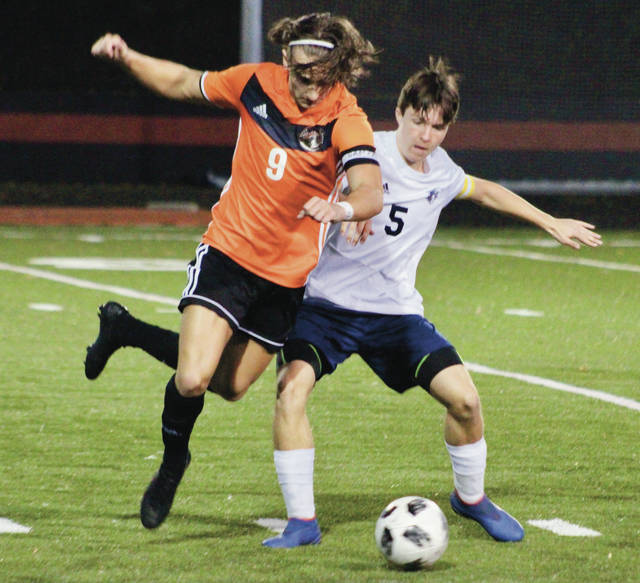 Hayes' Briggy Kannally (9) and Whetstone's Louis Schirmer battle for possession during the first half of Tuesday's Division I district tournament game in Delaware.