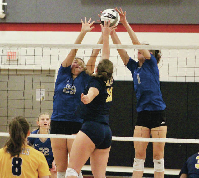 Olentangy Liberty's Ali Sebenoler (29) and Claranne Fechter (1) combine for a block during the first set of Thursday's Division I district semifinal against Lancaster.