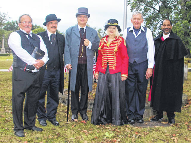 Pictured are six of the eight reenactors set to take part in the third annual Oak Grove Cemetery Walk scheduled for Oct. 13. Pictured, left to right, are Steve Shaw, portraying Rev. Henry Van Deman; Steve Frazier, portraying David Grinton; Steve Berry, portraying Frederick P. Vergon; Nancy Fleming, portraying Baroness Viola (Lytle) Üchtritz; Joe Dwenger, portraying Dr. Reuben Lamb; and Tracey Sumner Sr,. portraying John Freeman Shorter. Not pictured is Leslie Brown, portraying Sarah Ann Moore; and Sherry Lloyd, portraying Mary Frances (Alston) Austin.