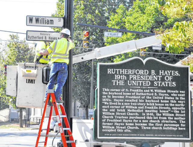 """Inside a brick house that once stood at 17 E. William St. in downtown Delaware, Rutherford Birchard Hayes was born 197 years ago today. Hayes, who went on to become the 19th president of the U.S., has been immortalized with a bronze statue that will be unveiled today at the southwest corner of William and Sandusky streets. Today's unveiling will take place at 6:30 p.m. during Main Street Delaware's First Friday celebration. While the statue took a tour of the city Wednesday afternoon in the back of a pickup truck, city crews were busy installing honorary """"Rutherford B. Hayes Way"""" signs on various poles on William Street, including one at the corner of W. William and N. Franklin streets, where Hayes' boyhood home once stood."""