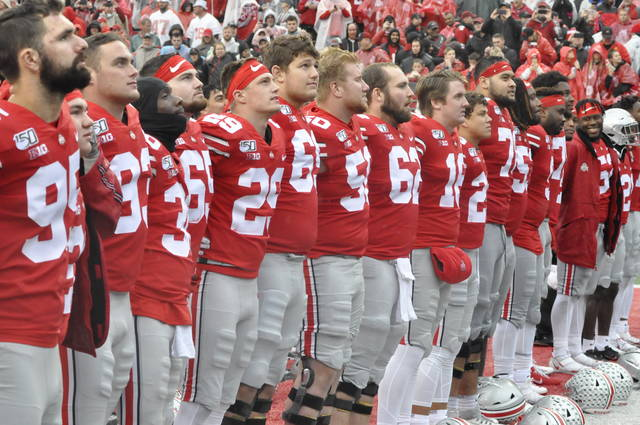 Ohio State players sing Carmen Ohio following their 38-7 win over Wisconsin in Ohio Stadium on Saturday.