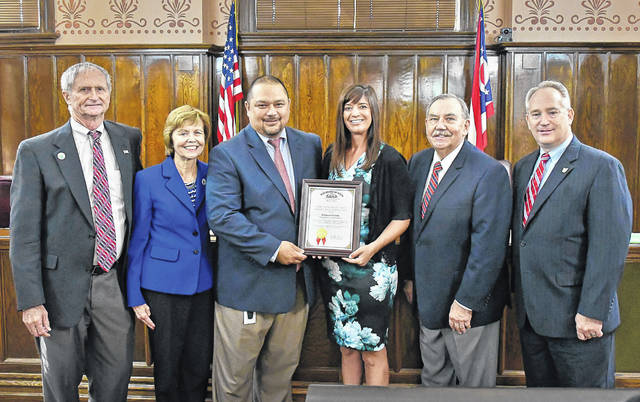Ohio Auditor of State Keith Faber presented Delaware County Auditor George Kaitsa and his staff with the Ohio Auditor of State Award with Distinction Wednesday for a clean audit. Pictured, left to right, are Commissioner Gary Merrell, Commissioner Barb Lewis, Chief Deputy Auditor Seiji Kille, Senior Accountant Dawn Hall, Auditor George Kaitsa, and Ohio Auditor of State Keith Faber.