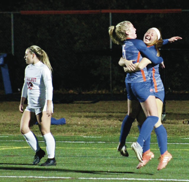 Orange's Grace Poorbaugh, right, and Maia Kaufman celebrate after Poorbaugh scored to put the Pioneers up 3-1 during the second half of Wednesday's Division I district semifinal against visiting Big Walnut.