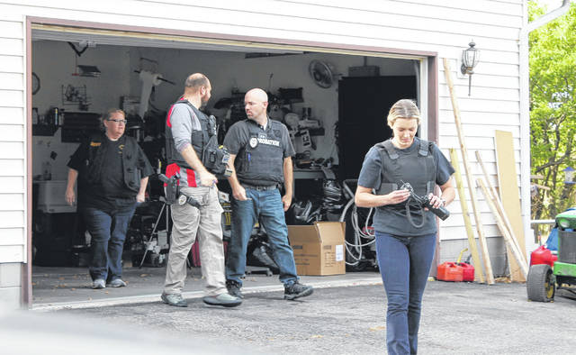 Pictured are law enforcement officials performing a residential compliance check.