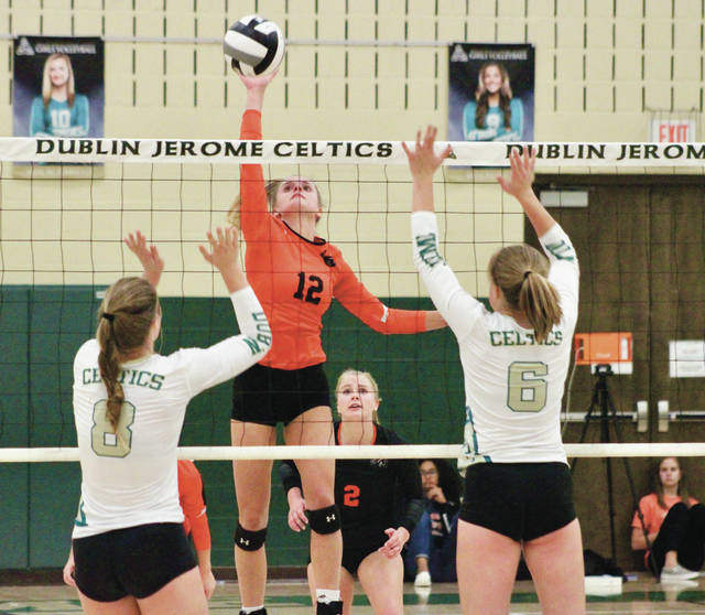 Hayes' Hadlee Bruns floats a shot over the net during the first set of Monday's Division I district tournament game against host Dublin Jerome.