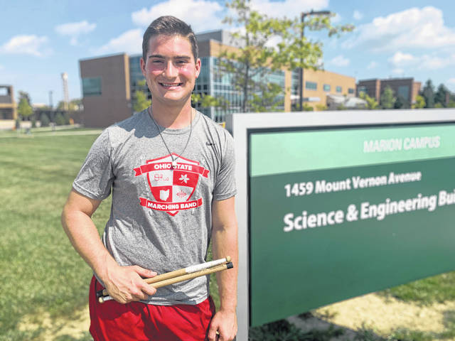 Caleb Richardson, a Hayes graduate and member of the Ohio State University Marching Band, poses for a photo in front of the Science & Engineering Building located on the OSU at Marion campus.