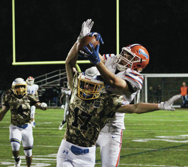Olentangy Orange's Sam Wyne hauls in a catch over Olentangy's Hunter Boehm (17) during the second half of Friday's game in Lewis Center.