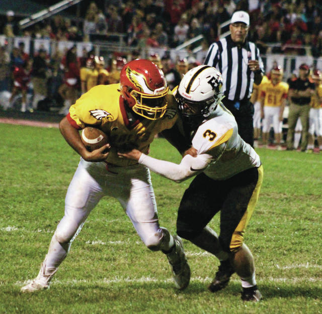 Big Walnut's Tyler Crotinger tries to break free from Franklin Heights' Devin Buchanan (3) during the first half of Friday's OCC showdown in Sunbury.