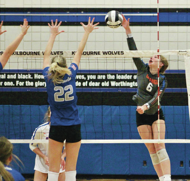 Olentangy Orange's Molly Shomock (6) winds up for a shot as Olentangy Liberty's Logan Flaugh (22) tries for a block during the first set of Thursday's Division I regional semifinal at Worthington Kilbourne.