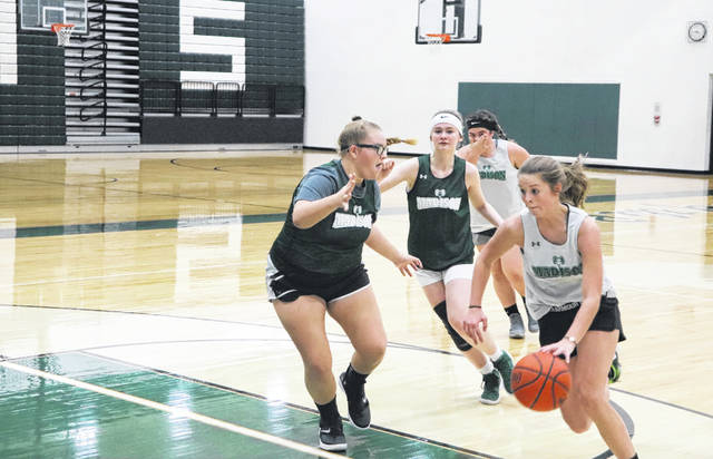 After suffering a concussion during a game several months ago, Elizabeth Harry, far left, is back to playing basketball.