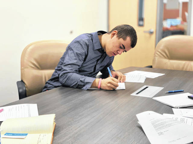 Duckworth fills out paperwork for the apprenticeship program. Duckworth has a list of responsibilities at Corna Kokosing, and the career center will work with the company to do on-site visits and evaluations.