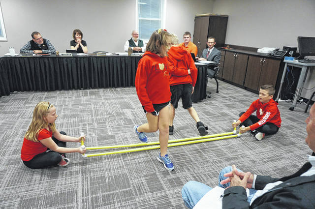 """At the October Big Walnut Board of Education meeting, students demonstrate a dance they learned in physical education to the song """"We Will Rock You."""""""