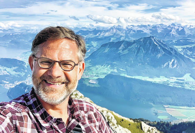 Travel guide author and Ohio Wesleyan graduate Cameron Hewitt, shown at Mount Pilatus in central Switzerland, will discuss his career, including his longtime collaboration with TV and radio personality Rick Steves, during a Nov. 14 presentation at OWU.