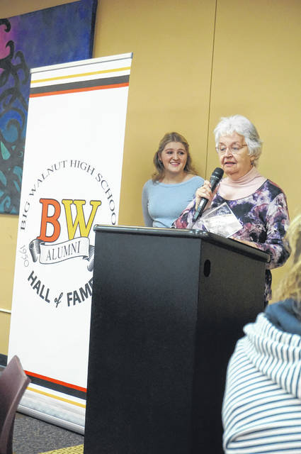 Polly Horn speaks after being inducted into the Big Walnut Hall School Alumni Hall of Fame Nov. 11. Junior Maddy Watters, who introduced Horn, stands to her left.