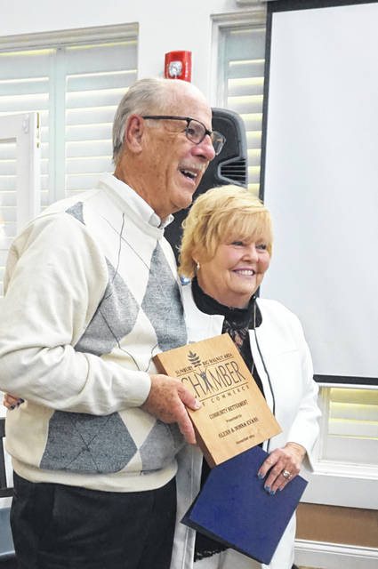 Glenn and Donna Evans hold the Community Betterment Award they received Thursday from the Sunbury/Big Walnut Area Chamber of Commerce.