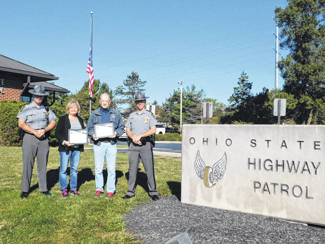 "Richard E. Conway and Carol J. Conway, of Ostrander, recently accepted their ""Saved by the Belt"" certificates during a ceremony held at the Delaware Post of the Ohio State Highway Patrol in Delaware last month."