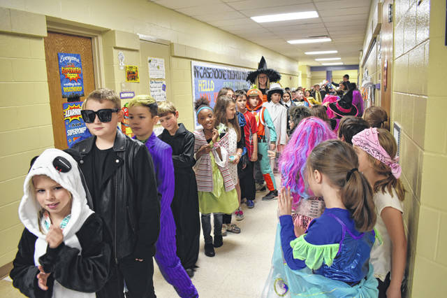 Students at Schultz Elementary School in Delaware parade around the halls dressed as their favorite characters for Halloween. Students went down each hallway and met up with hundreds of parents in the cafeteria and gym.
