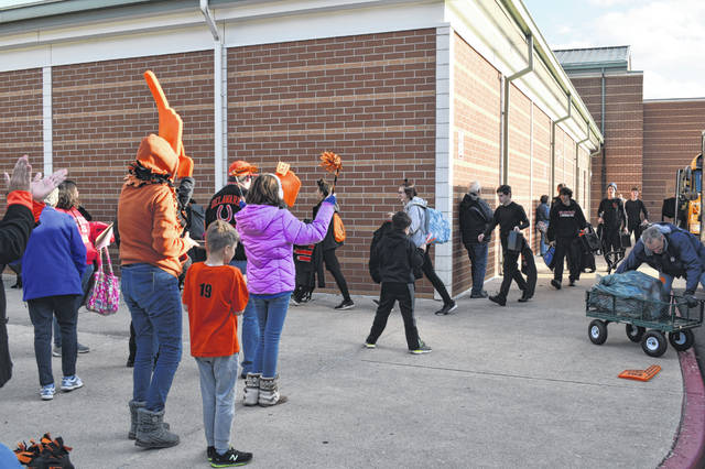 After returning from the state finals Saturday, members of the Hayes Marching Band were greeted at the school by family and friends.