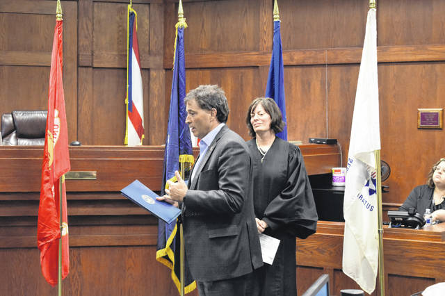 Ohio Congressman Troy Balderson (R) addresses and congratulates the four veterans who completed Delaware Mission Court. Balderson, as well as state Sen. Andrew Brenner (R-Powell) and Delaware Mayor Carolyn Riggle, praised the work of the court and the veterans who completed the program.
