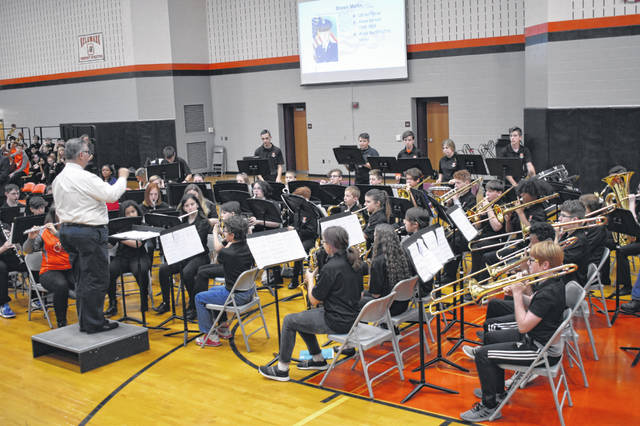 Band members at Dempsey Middle School play the official songs of each branch of the military during the Veterans Day assembly. Veterans were encouraged to stand when their song was played and students cheered and applauded them.
