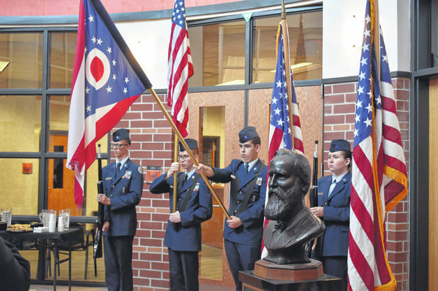 Members of the Delaware County Air Force JROTC present the colors before the bust of President Rutherford B. Hayes Thursday during the dedication ceremony in the rotunda of Hayes High School.