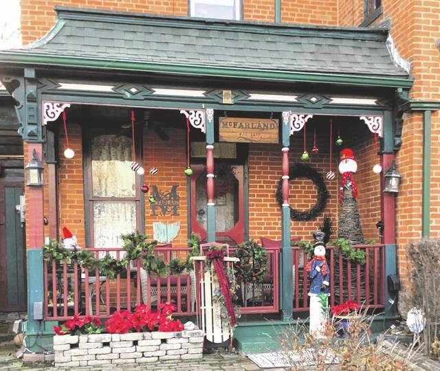 One of three historic homes in Ashley that will be open to the public is Al and Elaine McFarland's historic grand 1860 home at 219 E. High St. The home is not ready for the Christmas season until every bit of the house is decorated, including the porch.