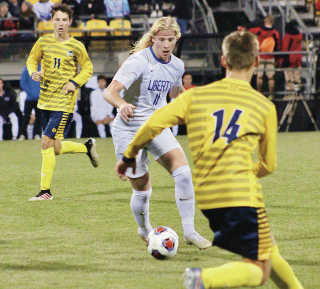 Olentangy Liberty's Jaggar Brooker dribbles through the St. Ignatius defense during the first half of Sunday's Division I state championship at Mapfre Stadium.