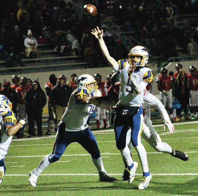 Olentangy quarterback Trent Maddox fires a touchdown pass during the first quarter of last Friday's Division II regional championship against Toledo Central Catholic. Maddox had a solid season en route to leading the Braves to the third round of the playoffs, completing 237 of his 370 passes for 2,797 yards and 28 touchdowns — numbers good enough to earn him All-Delaware County Offensive Player of the Year honors. Olentangy Orange linebacker Zach Hill nabbed Defensive Player of the Year recognition. For a complete list of the teams, see page 9.