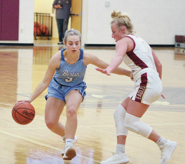 Olentangy Berlin's Haley Cera, left, looks to drive past Watterson's Paige Woodford during the first half of Monday's non-league showdown in Columbus.