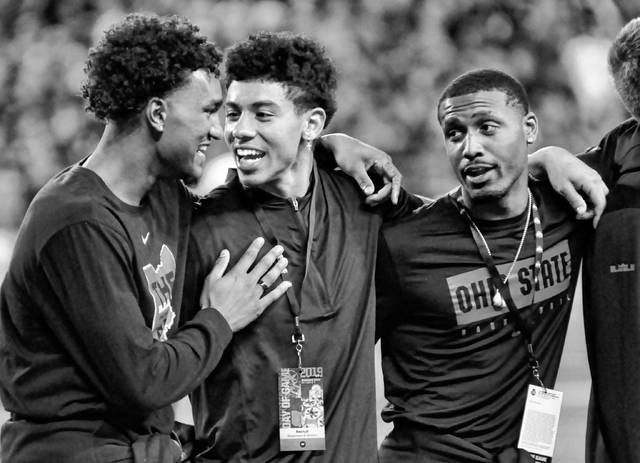 The Ohio State men's basketball team was recognized on the field during the football team's Oct. 5 game against Michigan State. Pictured, left to right, are junior guard Musa Jallow, freshman guard D.J. Carton, and sophomore guard Luther Muhammad.