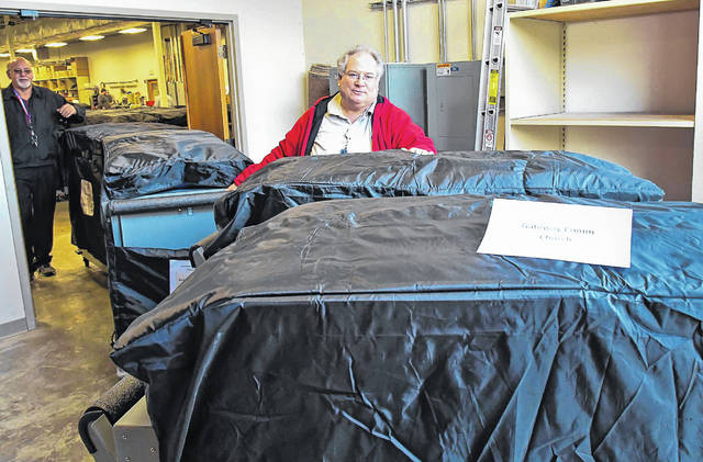 Staff at the Delaware County Board of Elections office began moving voting equipment to the county's 165 precincts Thursday morning. Charlie Crum, left, rolls voting equipment from the BOE warehouse to John Helwig, right, so it can be loaded into delivery trucks going to the precincts.