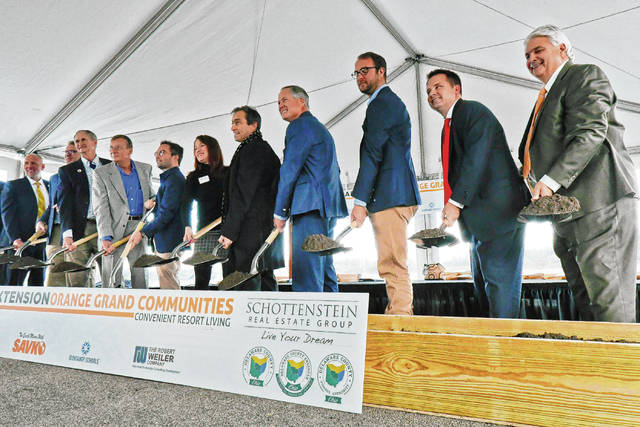 Representatives from a public-private partnership broke ground on the Home Road extension Thursday morning.